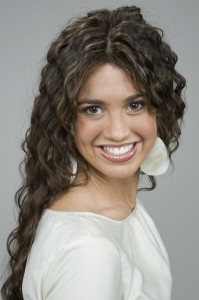 Model with curly dark hair